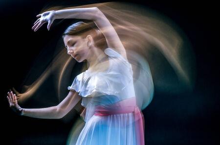 ballet dancing: beautiful female dancer  playing her part