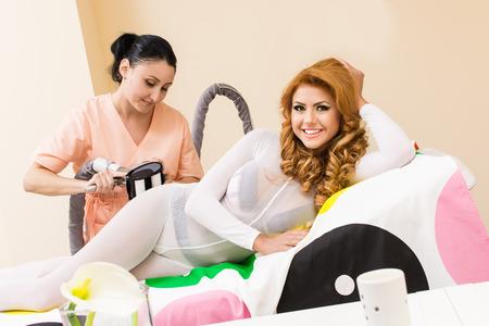 lymphatic drainage therapy: beautiful woman reciving a massage transdermal