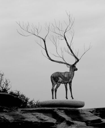 Sculpture of deer on rock platform Stock Photo - 13643205