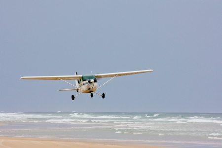 Airplane takes off from beach Stock Photo - 13742921