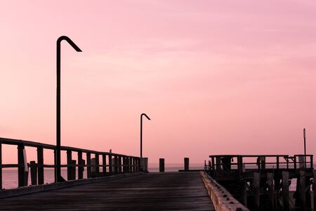 Sunset at beach jetty wharf on Fraser Island, Australia Stock Photo - 13742876
