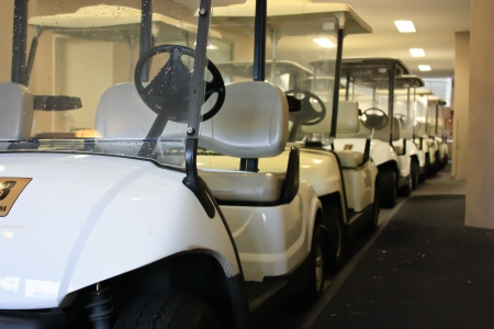 A row of golf cart buggies Stock Photo