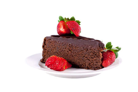 Slice of chocolate cake with strawberries isolated Stock Photo - 13949324