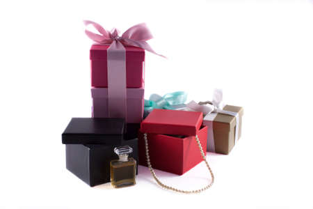 Gift boxes with pearls and perfume isolated on white Stock Photo