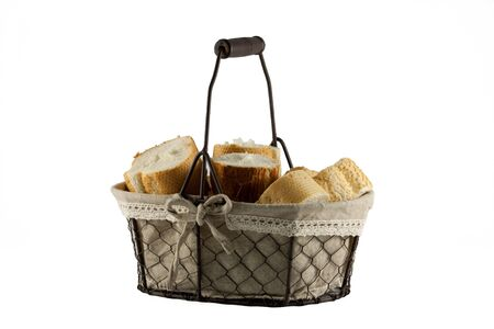 Fresh bread rolls in wire basket isolated on white background Stock Photo - 14387145