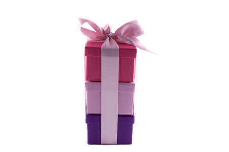 Gift boxes wrapped in pink bow isolated on white