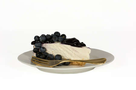 Slice blueberry cheesecake decorated with fresh blueberries isolated on white Stock Photo - 14537031