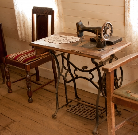 antique chair: Vintage sewing machine on old table Stock Photo