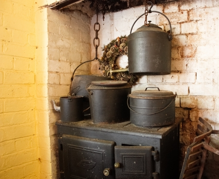 vintage kitchen: Vintage wood stove with cooking pots Stock Photo