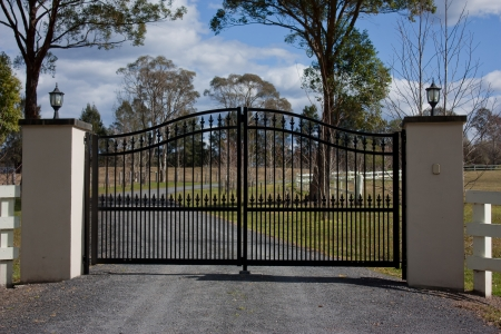 Black wrought iron entrance gates photo