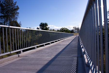 Steel and concrete pedestrian walkway bridge Stock Photo