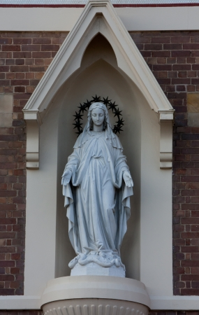 Statue of Virgin Mary in Archway on church