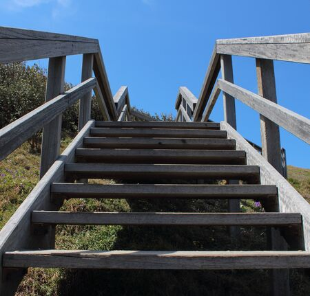 Outdoor wooden stairs against blue sky