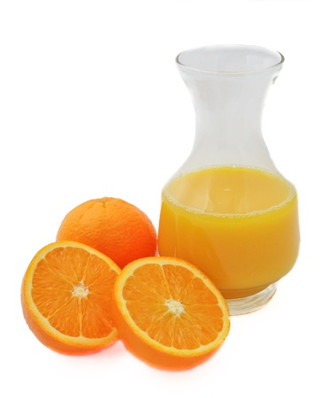 Jug of orange juice with oranges isolated on white background Stock Photo - 15906857