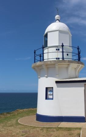 Lighthouse on cliff against blue sky and ocean, Australia Stock Photo - 16403427