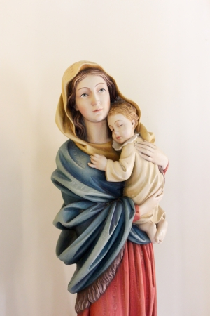Statue of Virgin Mary holding baby Jesus