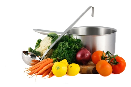 Soup pot, ladle, fresh vegetables isolated on white Stock Photo
