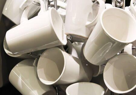 White coffee mugs hanging on tree Stock Photo - 17435415