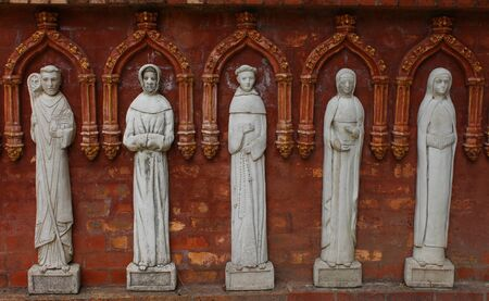 Statues of former Popes in church garden wall Stock Photo - 17435428