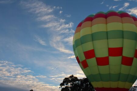 Hot Air Balloon against blue sky at sunrise