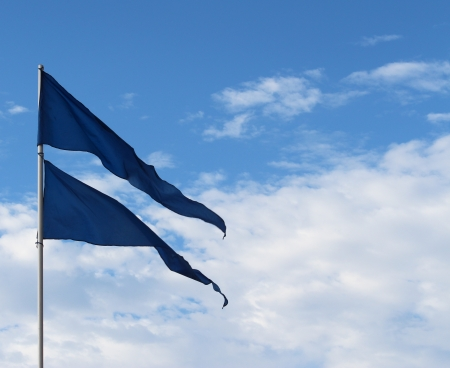 Blue triangular flags blowing in wind Stock Photo - 17901977