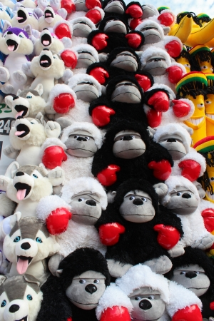 Stuffed toy prizes at amusement park Stock Photo