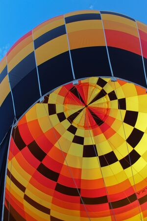 Yellow, red, black checked hot air balloon Stock Photo