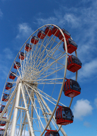 Ferris wheel at amusement park against blue sky