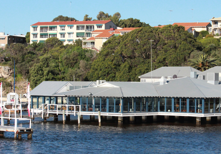 Waterfront restaurant atop a pier Stock Photo - 23320255