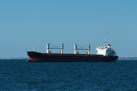 Cargo freight ship on calm water
