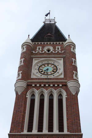 Historic clock tower with arched window set in brick