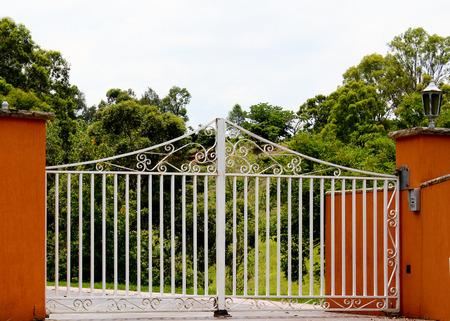 White wrought iron entrance gates