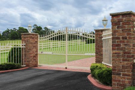 fence: Wrought iron driveway entrance gates