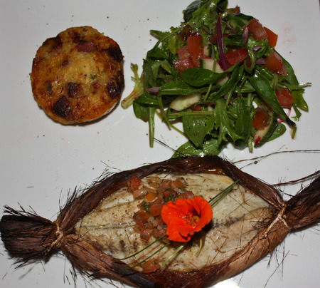Fish served on bark platter with salad healthy meal Stock Photo