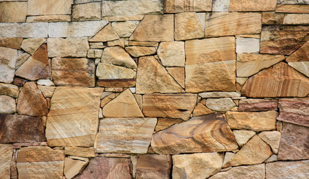 Sandstone brick wall ideal as background Stock Photo