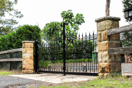 entrances: Black metal driveway entrance gates