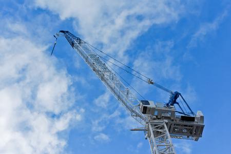 Industrial construction building crane against blue sky Stock Photo