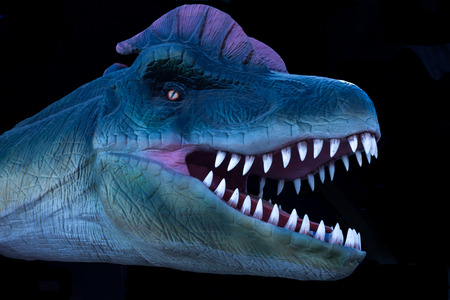 ancient creature: Prehistoric dinosaur model head isolated on black background Stock Photo