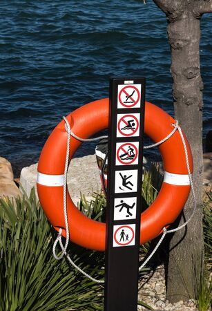 Life preserver buoy set on banks of harbour Stock Photo