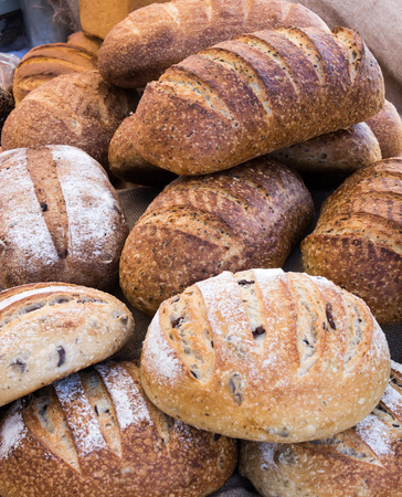 Loaves of freshly baked wholemeal and sourdough breads