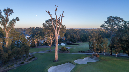 Aerial view of golf course early morning showing bunkers, dams, fairways and greens in Sydney Australia Stock Photo