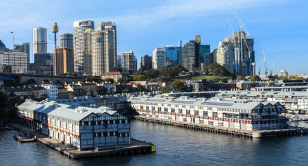 Walsh Bay finger wharves on Sydney Harbour Australia with city buildings in background Editorial