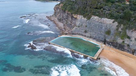 Aerial view of ocean seaside swimming pool at Bilgola Beach, Sydney Australia