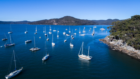 Aerial view of boats moored on Hawkesbury River, Brooklyn Australia Stock Photo