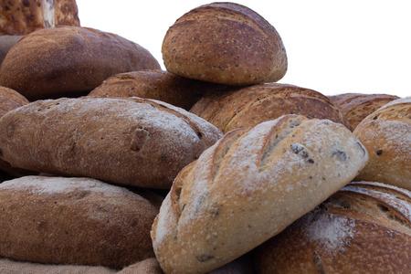Freshly baked loaves of multigrain and sourdough bread