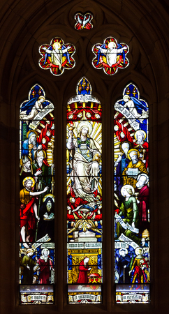 Stained glass cathedral church windows depicting religious scenes