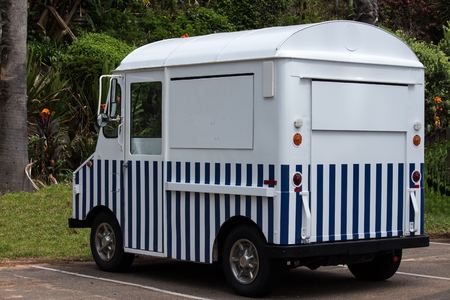 Blue white striped food van truck parked after close of business Фото со стока