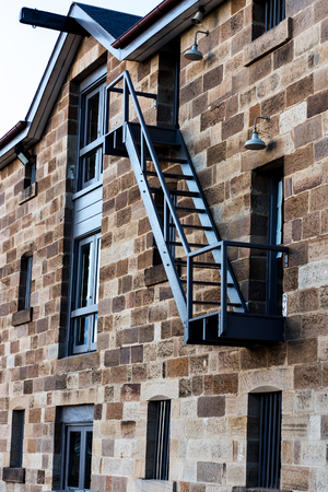 Sandstone brick building exterior with stairway fire exit