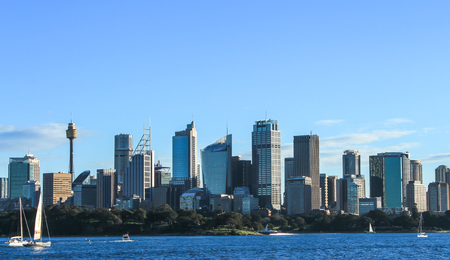 Sydney city cbd buildings with harbour and boats in foreground, Australia Редакционное
