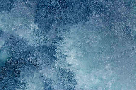 Aquatic background of sea surf waves close up with clear water and white foam